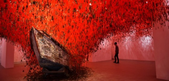 """A visitor looks at """"The Key in the Hand"""" a piece of art by Japanese artist Chiharu Shiota presented at Japan's pavilion during the 56th International Art Exhibition (Biennale d'Arte) titled """"All the World's Futures"""" on May 5, 2015 in Venice. AFP PHOTO / GABRIEL BOUYS == RESTRICTED TO EDITORIAL USE, MANDATORY MENTION OF THE ARTIST TO ILLUSTRATE THE EVENT AS SPECIFIED IN THE CAPTION ==="""